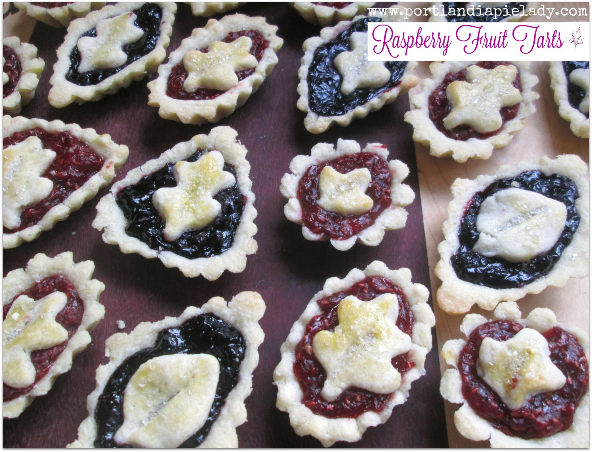 Raspberry Fruit Tarts: Super easy and perfect way to use up some of your frozen berries (or fresh), filled in a sweet buttery crust!