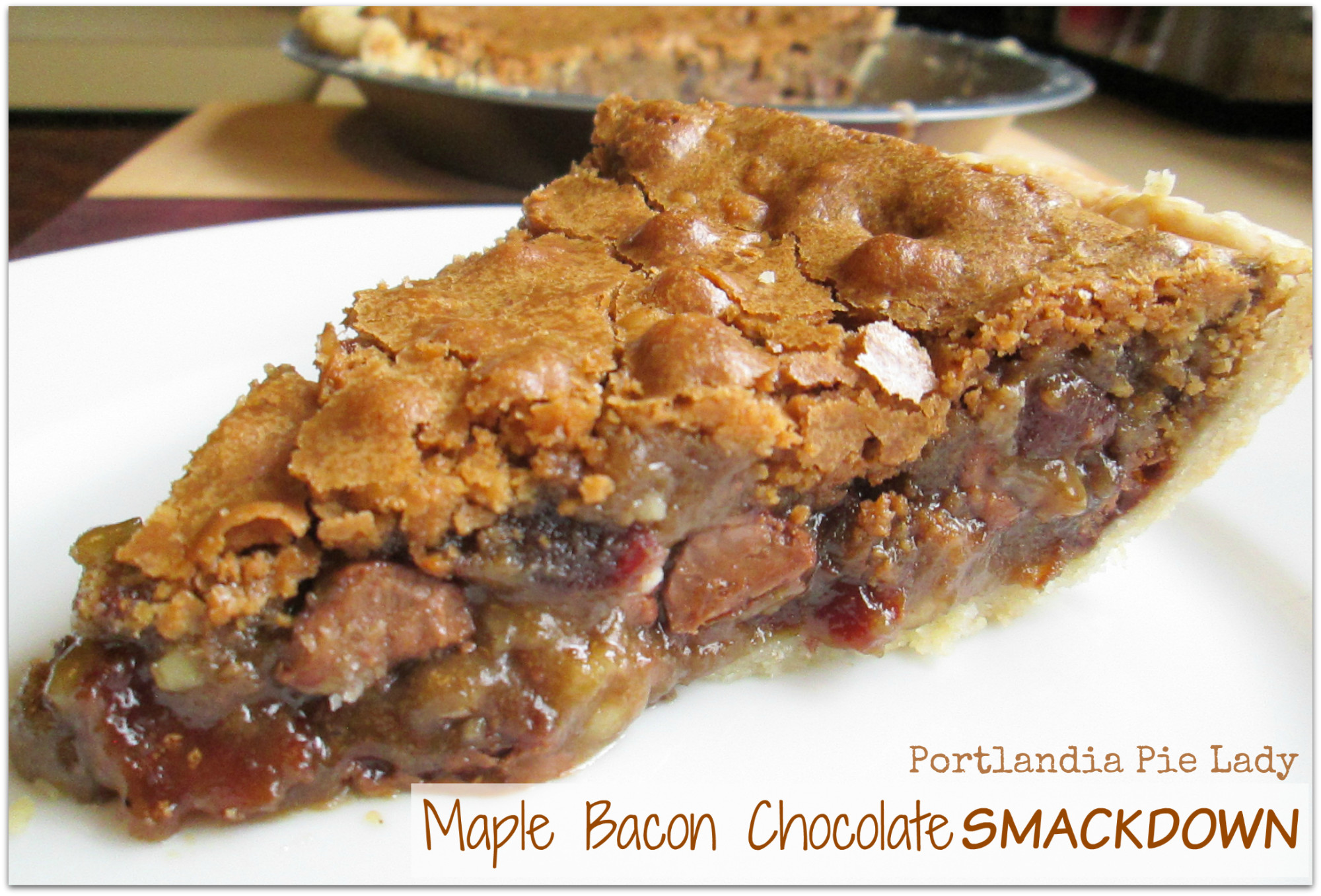 Maple Bacon Chocolate Smackdown!  Chocolate, Bacon, Maple and Walnuts baked in a butter batter; the main event is the eating.